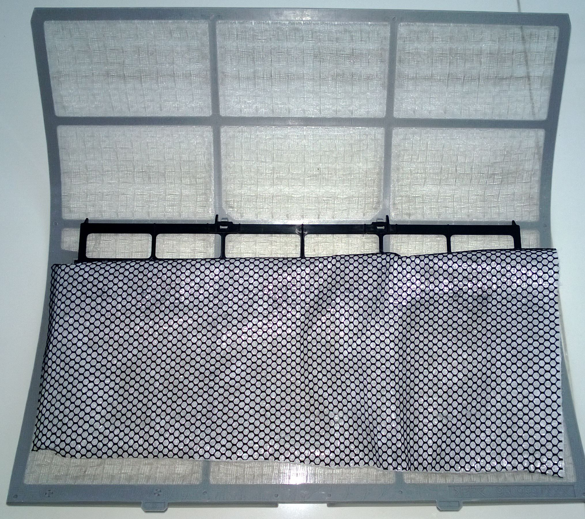 air conditioning filters. the black mesh is carbon \u0026 membrane filter behind it. just stick air conditioning filters