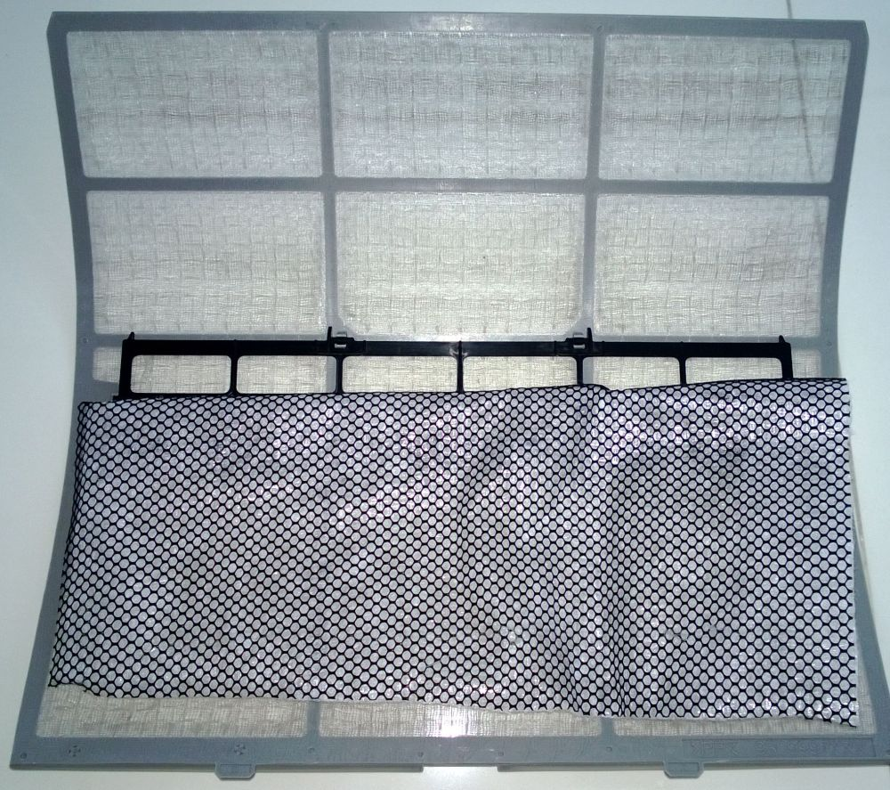 The black mesh is the carbon & the membrane filter is behind it. Just stick it or place it behind the normal air-con filter, then reinstall your air-con filter.